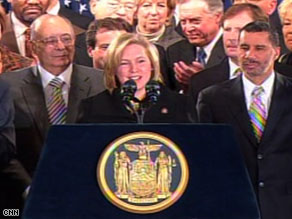 Rep. Kirsten Gillibrand thanks Gov. David Paterson, right, after her appointment to the Senate on Friday.