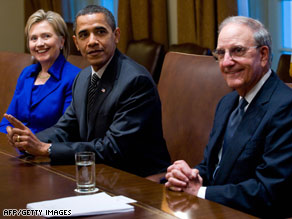 George Mitchell, right, meets with Secretary of State Hillary Clinton and President Obama on Monday.