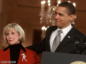 President Obama stands with Lilly Ledbetter shortly before he signed the bill bearing her name Thursday.