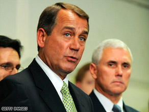 House Minority Leader John Boehner, center, and GOP Rep. Mike Pence, right, speak with reporters Tuesday.
