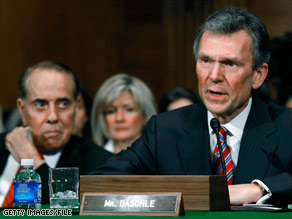 Former Sen. Tom Daschle answers questions during a confirmation hearing January 8.