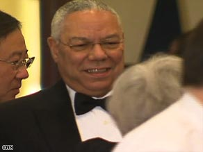 Colin Powell chats with other guests at the Alfalfa dinner in Washington on Saturday night.