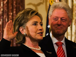 Bill Clinton looks at his wife Secretary of State Hillary Clinton as she is sworn in on February 2.