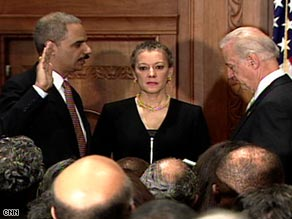 Vice President Joe Biden swears in Eric Holder, left, as attorney general Tuesday at the Justice Department.
