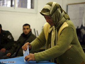 An Israeli voter casts her ballot on Tuesday.