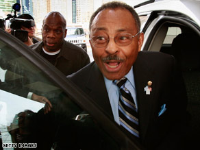 U.S. Sen. Roland Burris leaves a news conference on Sunday in Chicago, Illinois.