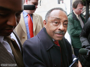 Sen. Roland Burris, who is under fire to resign, arrives at a Chicago City Club luncheon to speak Wednesday.