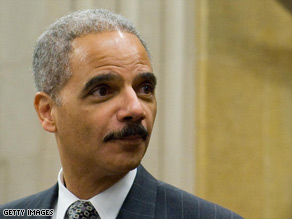 Attorney General Eric Holder helps celebrate Black History Month at an event Wednesday at the Justice Department.