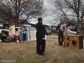 A deputy oversees an eviction in Lafayette, Colorado, last week.