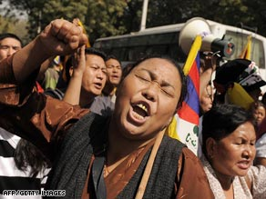In India on Wednesday Tibetans living in exile protest Chinese rule in Tibet.