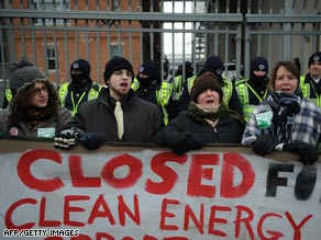 Demonstrators stand outside the Capitol Power Plant in Washington on Monday to protest the plant's use of coal.
