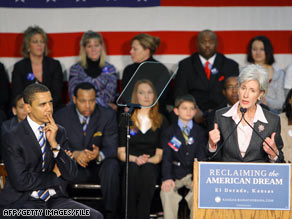 Then-presidential candidate Barack Obama listens to Gov. Kathleen Sebelius during a January 2008 rally.