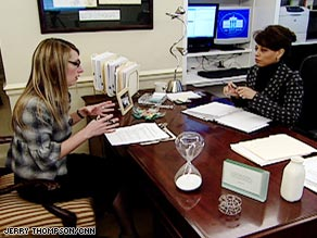 White House Domestic Policy Director Melody Barnes, right, meets with a member of her staff.