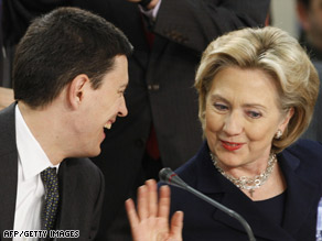 British Foreign Minister David Miliband and Hillary Clinton talk Thursday at NATO headquarters in Brussels.