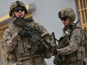 U.S. troops secure a street in in the southern Dura district of Baghdad, Iraq, this week.