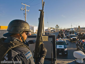 Mexican federal police patrol last week on the streets of Ciudad Juarez, just across the border from El Paso, Texas.