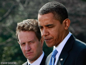 Treasury Secretary Tim Geithner, left, stands with the president at a press conference Wednesday.