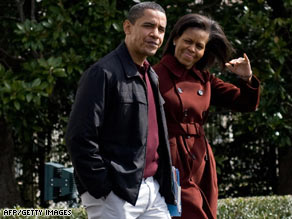 As Democratic volunteers met Saturday, President Obama and his wife, Michelle, flew to Camp David.