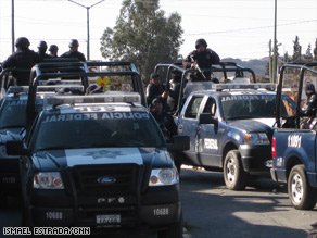 A police convoy moves in Ciudad Juarez, Mexico, last month, across the U.S. border from El Paso, Texas.