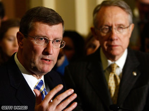 Sen. Harry Reid, right, says he expects Sen. Kent Conrad's version of the budget to pass..