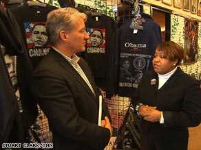"""Across the storefront at Afroworld, a banner reads, """"Obama 2012."""""""