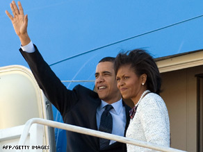 Barack and Michelle Obama wave from Air Force One before their departure for Europe.