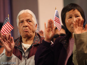 New citizens take the oath of citizenship during ceremonies in Montebello, California, earlier this year.