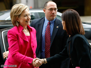 Secretary of State Hillary Clinton is greeted at the Inter-American Development Bank April 14.