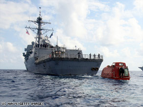 The USS Bainbridge tows the lifeboat in which Capt. Robert Phillips was held for days.