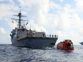 The USS Bainbridge tows a lifeboat in which the captain of the Maersk Alabama was held hostage.