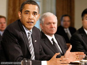President Obama meets Monday with his Cabinet, including Defense Secretary Robert Gates, right.
