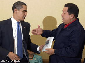 Venezuelan President Hugo Chavez presents a book to President Obama at the Summit of the Americas.