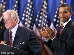 Democratic Sen. Ted Kennedy, left, introduces President Obama at the bill signing on Tuesday.