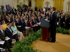 President Obama speaks at a news conference about his first 100 days in office.