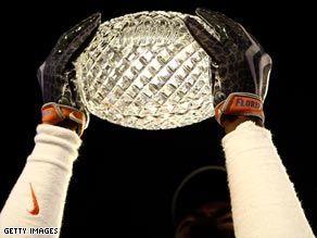 College football teams play in the BCS for the national championship trophy.