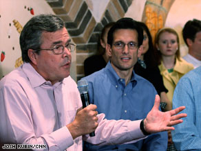 Rep. Eric Cantor, right, listens as former Florida Gov. Jeb Bush offers advice for the GOP.