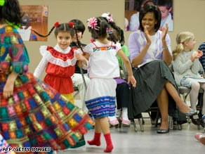 Michelle Obama encourages the performers at the Latin American Montessori Bilingual school Monday.