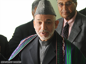 Hamid Karzai departs after registering as a candidate for August presidential elections in Kabul on Monday.
