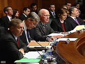 From left: Sens. Lindsey Graham, Sheldon Whitehouse,