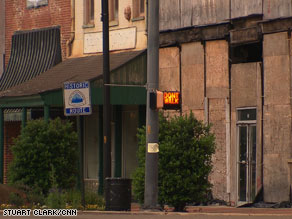 Storefront after storefront are closed and buildings are boarded up and falling into disrepair in Selma.
