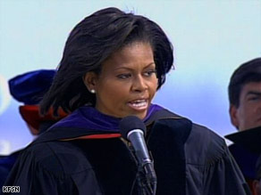 Michelle Obama tells graduates they are blessed and in exchange must give something back.