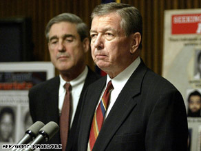 Robert Mueller, left, and John Ashcroft, seen in 2004, won't have to give depositions on detentions after 9/11.