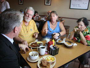 CNN's John King, from left, talks health care with diners Stafford Ezzard and Margaret and Blanche Dormady.