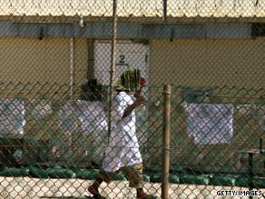 A detainee walks at Camp 4 detention facility at Guantanamo Bay, Cuba, in May.