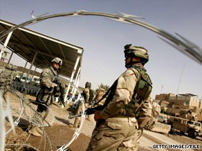 U.S. soldiers stand guard in Baghdad, Iraq, in March.