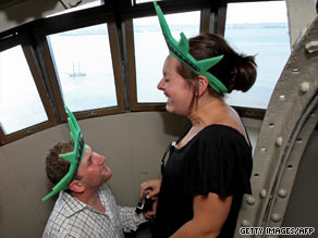 Aaron Weisinger proposes to Erica Breder on July Fourth inside the crown of the Statue of Liberty.