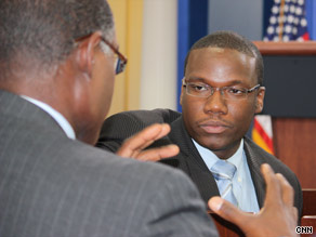 Kevin Lewis, center, enjoys a conversation with President Obama.