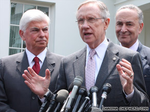 Sen. Harry Reid, center, talks about health care flanked by Sens. Christopher Dodd, left, and Charles Schumer.