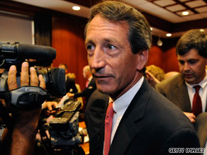 Joel Sawyer, Mark Sanford&#039;s former spokesman, is seen here behind the governor in June.
