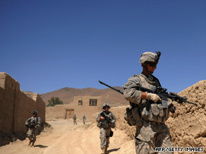 "U.S. soldiers patrol an eastern Afghan village. President Obama has called Afghanistan a ""war of necessity."""